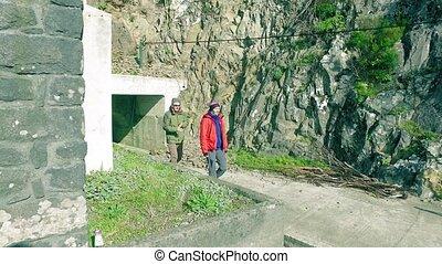 Tourists Walking on Hiking Pathway Levada Waterway, Madeira...
