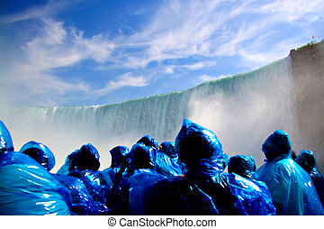 Tourists watching Niagra Falls from a boat