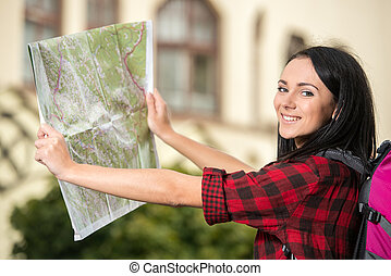 Tourists - Young pretty woman, tourist with touristic map in...