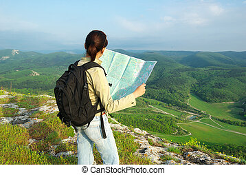 Toutist read the map - Girl tourist in mountain read the...