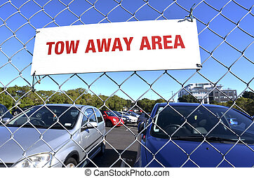 Tow away area sign in a parking lot.