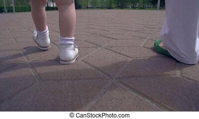 Toward Future - Slow motion of unrecognizable child walking...