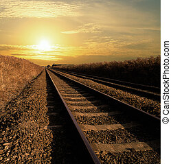 Towards the light - Rail track going into infinity with the...