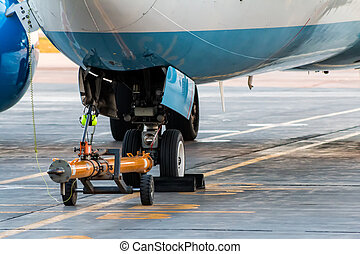 Towbar attached to the front landing gear of the airplane