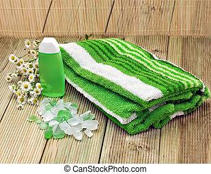Towel and bath salts. Spa background