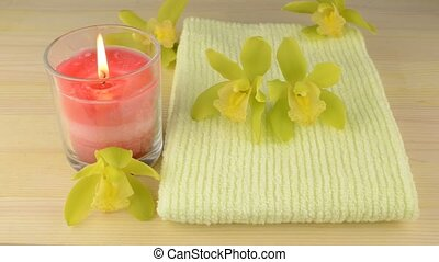 Towel and glass candle - Green towel and glass candle with ...