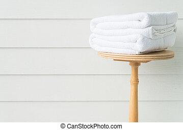 Towel bath on wood table