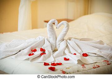 towel decoration in hotel room, birds, swans
