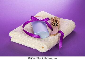 Towel, hairbrush and shampoo - Towel, hairbrush and the...