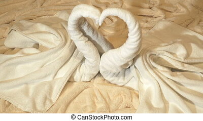 Towel set in view white swans decoration in form heart on...