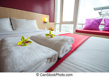Towels and Beautiful bedroom interior
