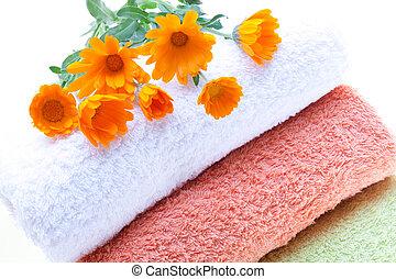 Towels And Calendula Flowers