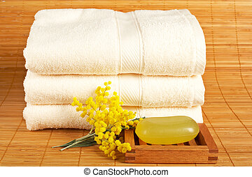 Towels and soap - Bath accessories and beauty products on...