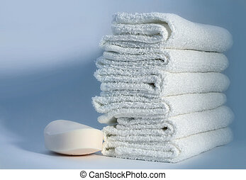 Towels and soap - White towels and soap on a blue background