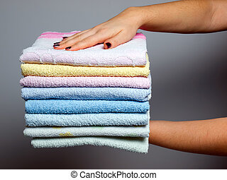 Towels batch - Woman is holding  batch of clean towels...