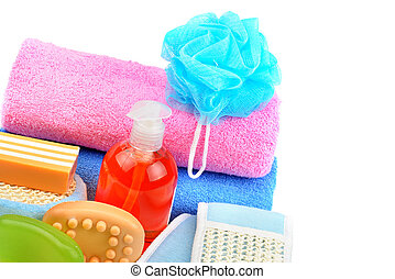 Towels, cosmetic soap and shampoo isolated on white background. Free space for text.