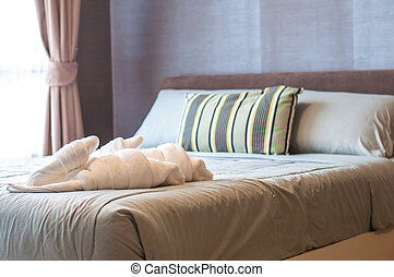 Towels on bed background