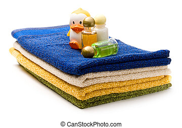 Towels, shampoo bottles and duck