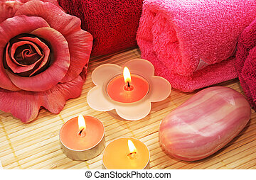 Towels, soaps, flowers, candles
