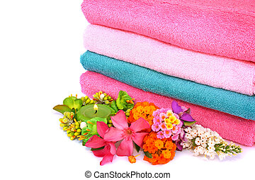 Towels - Stack of clean colorful towels with candle and...