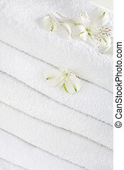 Towels - White towels decorated with white flowers for...
