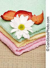 towels with a daisy and rose petals