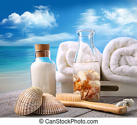 Towels with bath accessories at the beach
