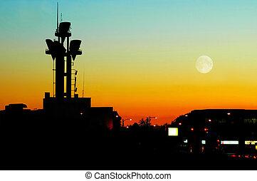 A telecommunications tower antenna at dusk
