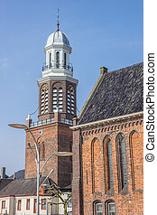 Tower and church on the central market square in Winschoten