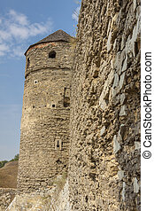 Tower and detail of wall - castle in Kamianets Podilskyi. Ukraine, Europe.