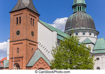 Tower and dome of the Emsland Dom church in Haren, Germany