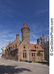 Tower and old houses in Bruges