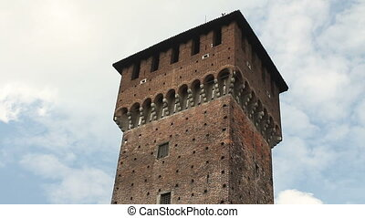 Tower and statue in Sforza Castle, a building of the 15th...