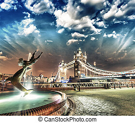 Tower Bridge at Night, London. Girl with a Dolphin Fountain in f