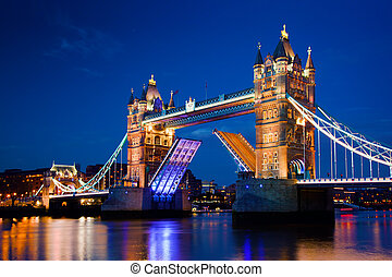 Tower Bridge in London, the UK at night. The bridge is ...