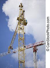 Tower building crane against the blue sky.