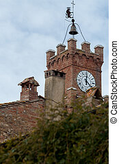 Tower clock in a little tuscany town