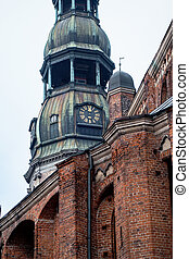 Tower clock of the famous St. Peter Church, Old town, Riga, Latvia