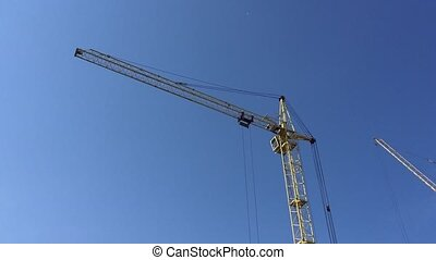 Tower construction cranes against the sky