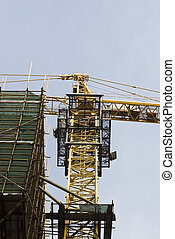 Tower crane at the construction site - Low angle view