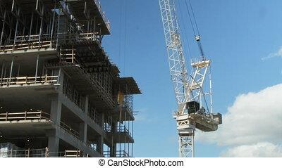 Tower crane at work. Timelapse.