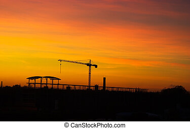 Tower crane in sunset