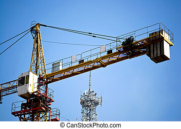 Tower Crane under blue sky at the Construction site