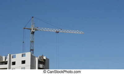 Tower cranes against blue sky