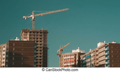 Tower cranes and building house.