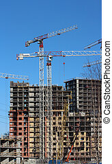tower cranes on construction site