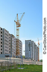 Tower cranes on the construction of two apartment buildings