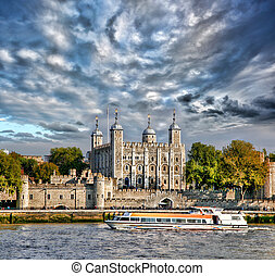 Tower Hill castle with boat in London,England,UK