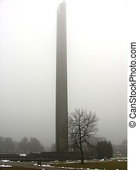 Tower in fog.