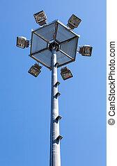 Tower lighting against blue sky
